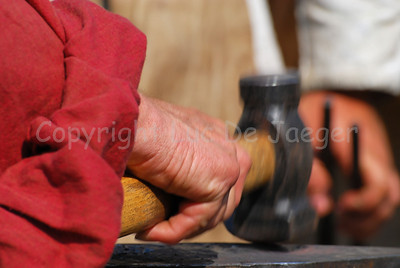A medieval smith at work during the Ommegang festivities in Brussels (Brussel), Belgium.