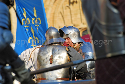 Knights in real plate armour and with real iron swords combating. Impressive to hear the sound of the crossing swords and the swords touching the body harness. At times the fights were very rude! It's all part of the events happening in the medieval village at the Place du Grand Sablon (Zavel) in Brussels, Belgium, during the Ommegang festivities.