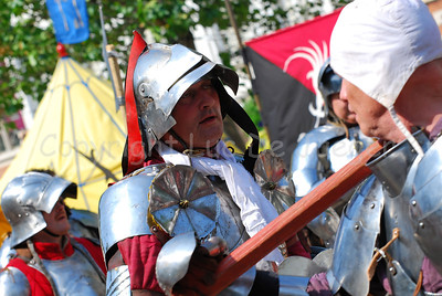 Knights in real plate armour and with real iron swords combating. Impressive to hear the sound of the crossing swords and the swords touching the body harness. It's all part of the events happening in the medieval village at the Place du Grand Sablon (Zavel) in Brussels, Belgium, during the Ommegang festivities.