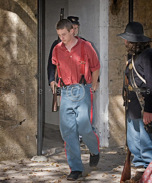A soldier charged with a killing is escorted to his trial.