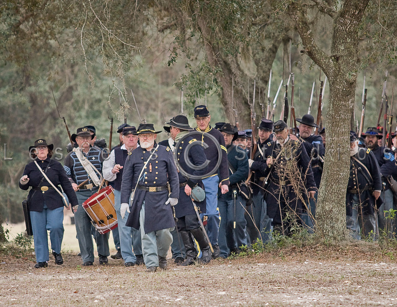 Union troops march in.