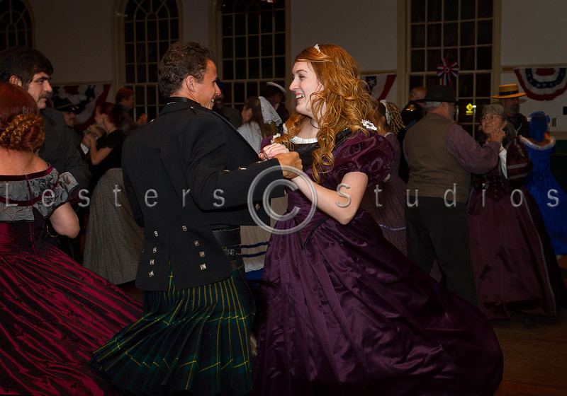 Fancy gowns, dress uniforms, and even kilts filled the floor with color.