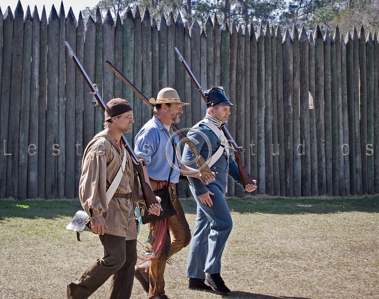 One regular and two militia members move out from the fort to confront the attacking Seminoles.