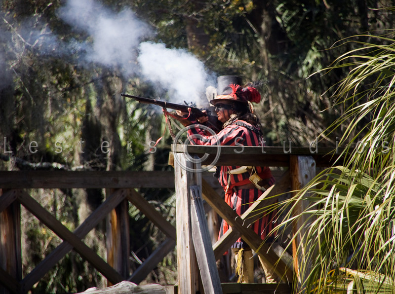 A Seminole skirmisher fires on the fort from the bridge