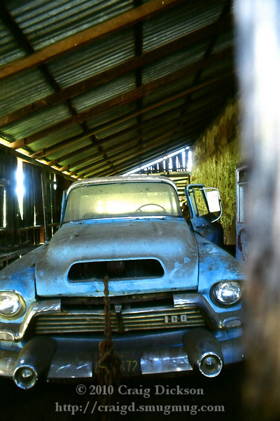 Peering through a crack into an abandoned garage