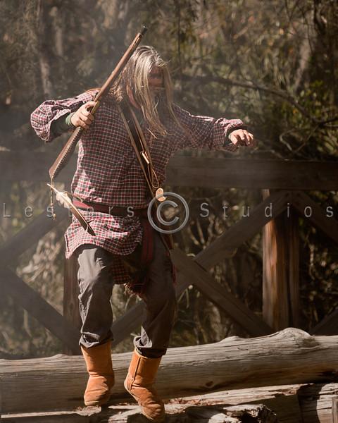 Seminole warriors rush across the bridge and take cover.