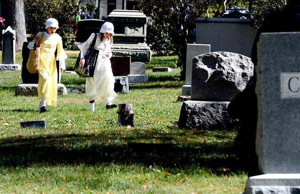 "Ella Schigur, left, and twin sister, Cali, provided water to the ghosts.<br /> The permanent residents of the historic Columbia Cemetery in Boulder came to life to tell their story on Sunday.<br /> For more photos and a video of the spirits, go to  <a href=""http://www.dailycamera.com"">http://www.dailycamera.com</a>. <br /> Cliff Grassmick  / October 7, 2012"