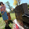 """""""Dorothy G. Howard"""" played by Alexis Bell, looks over her grave, waiting to tell her story to passers by. She was buried as a """"Jane Doe"""" until her true identity was determined much later.<br /> The permanent residents of the historic Columbia Cemetery in Boulder came to life to tell their story on Sunday.<br /> For more photos and a video of the spirits, go to  <a href=""""http://www.dailycamera.com"""">http://www.dailycamera.com</a>. <br /> Cliff Grassmick  / October 7, 2012"""