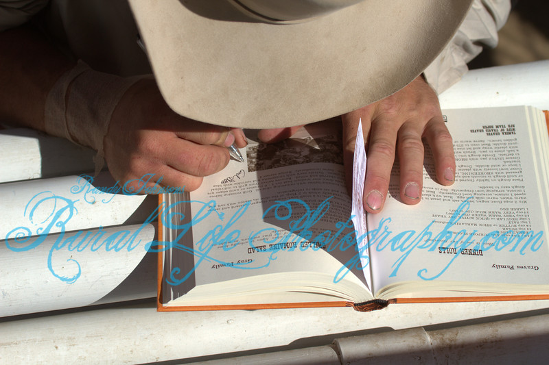 Bull Rider Autographing a Bring Em'on Home Cookbook .