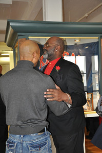 Darnell Valentine greets James Carr (Black suit)
