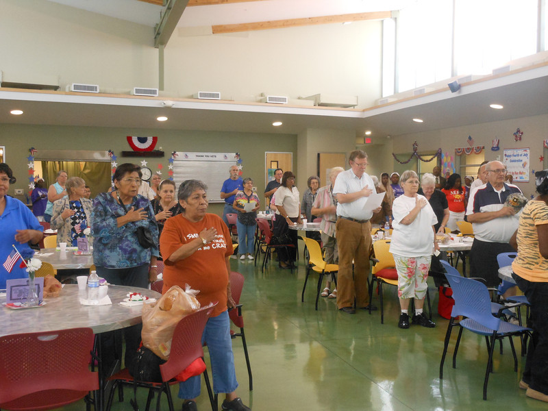 """June 19, 2012                    1st Annual Juneteenth Celebration<br />                                            Adam Diaz Senior Center, Phoenix<br /> <br /> The seniors and guests singing """"America"""" with the Buffalo Soldiers of the Arizona Territory."""