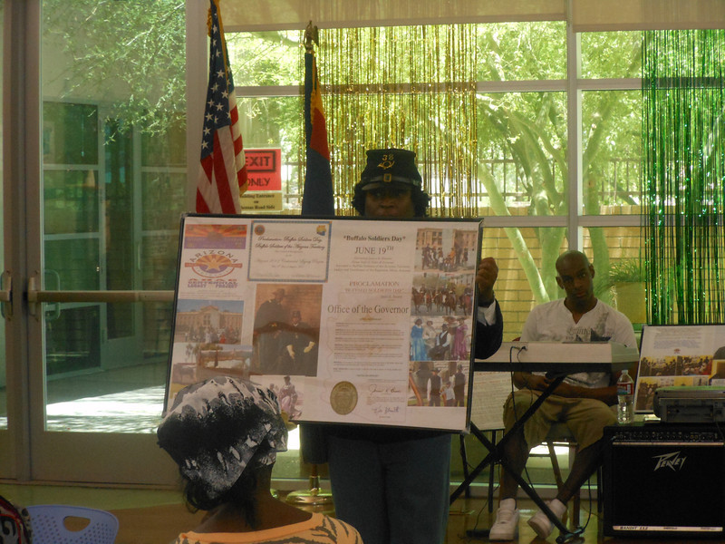 "June 19, 2012                1st Annual Juneteenth Celebration<br />                                       Adam Diaz Senior Center, Phoenix<br /> <br />               Pvt. Michelle London-Marable, Buffalo Soldier presents The Official Arizona Centennial Legacy PROCLAMATION ""Buffalo Soldiers Day"", June 19th and the Official Arizona Centennial Legacy Certificate awarded to The Buffalo Soldiers of the Arizona Territory - Ladies and Gentlemen of the Regiment, Mesa, Arizona, August 11, 2011.  <br /> <br /> Ownership: PROCLAMATION ""Buffalo Soldiers Day"", June 19th.  Years: 2009 to present."