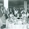 Seated: ?, ?, Carol McCartin, Gershom G.N. Tomlinson, Joann Levy, Mrs. Tomlinson