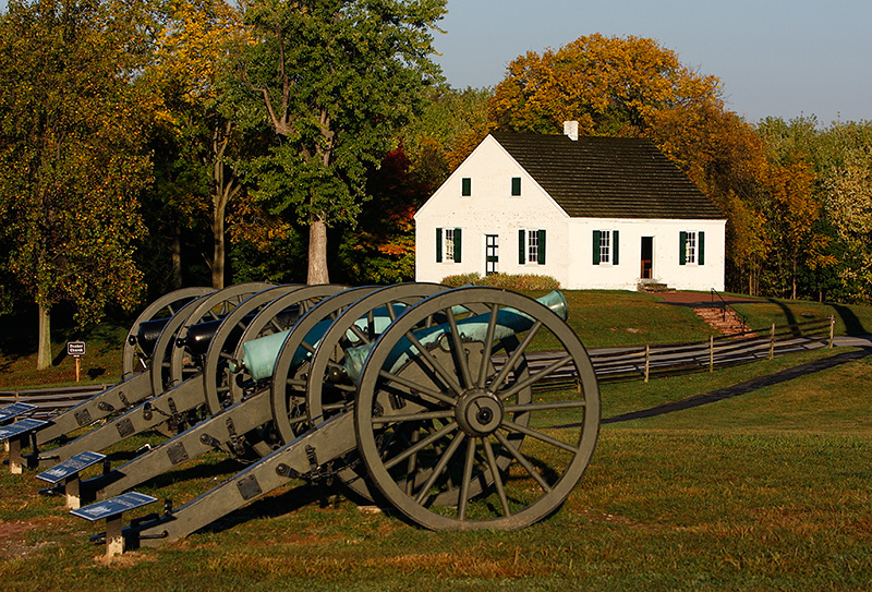 Dunker Church in the background of a civil war artillery battery. Quite a contrast of two opposites. One dedicated to saving lives and one to taking them. Both played a large roll at the battle for Antietam.
