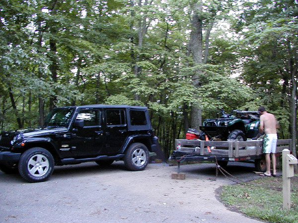 Kenny messing with the wagon. My jeep hauled all this stuff up to the lake!