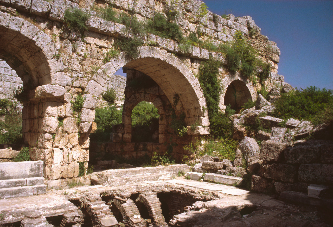 Remains of a Gymnasium in Perge, in southwestern Turkey.  The hypocaust is exposed beneath the floor in the foreground.  This is where furnaces sent hot air to warm the floor and walls of the building.
