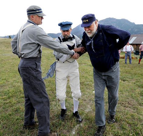 "Bruce ""Old Hoss"" Foster, right, gets help from John Exby and Robert Mitchell of the Territorial Allstar vintage baseball players.<br /> Walker Ranch celebrated Autumn with a demonstration of life in the 1880's and a vintage baseball game on Sunday.<br /> For more photos and a video of Walker Ranch, go to  <a href=""http://www.dailycamera.com"">http://www.dailycamera.com</a>.<br /> Cliff Grassmick  / September 30, 2012"