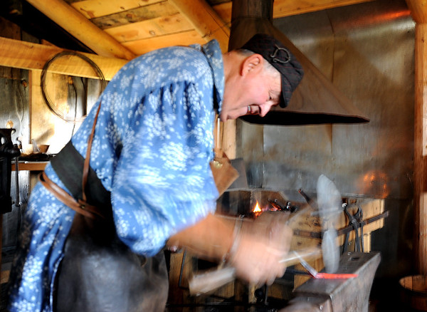 """Blacksmith Chuck Everitt  works his craft during Autumn Heritage Day at Walker Ranch.<br /> Walker Ranch celebrated Autumn with a demonstration of life in the 1880's and a vintage baseball game on Sunday.<br /> For more photos and a video of Walker Ranch, go to  <a href=""""http://www.dailycamera.com"""">http://www.dailycamera.com</a>.<br /> Cliff Grassmick  / September 30, 2012"""
