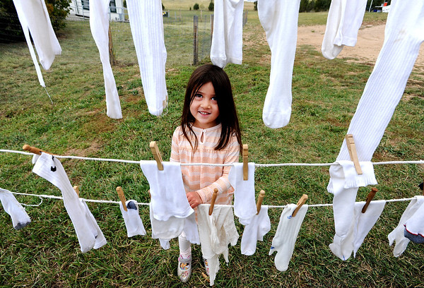 """Sophia Rears, 4, hangs up a sock she washed with a wash board at Walker Ranch.<br /> Walker Ranch celebrated Autumn with a demonstration of life in the 1880's and a vintage baseball game on Sunday.<br /> For more photos and a video of Walker Ranch, go to  <a href=""""http://www.dailycamera.com"""">http://www.dailycamera.com</a>.<br /> Cliff Grassmick  / September 30, 2012"""