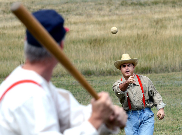 "Eric ""Cannon Ball"" Cohen pitches to Tiny Tim Heine during a 1880's vintage baseball game.<br /> Walker Ranch celebrated Autumn with a demonstration of life in the 1880's and a vintage baseball game on Sunday.<br /> For more photos and a video of Walker Ranch, go to  <a href=""http://www.dailycamera.com"">http://www.dailycamera.com</a>.<br /> Cliff Grassmick  / September 30, 2012"