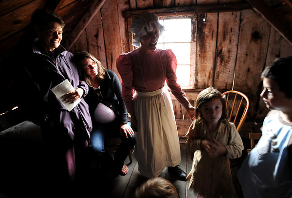 """Cindy Lawrence, left, and her daughter, Emily, listen to volunteer historian during Autumn Heritage Day.<br /> Walker Ranch celebrated Autumn with a demonstration of life in the 1880's and a vintage baseball game on Sunday.<br /> For more photos and a video of Walker Ranch, go to  <a href=""""http://www.dailycamera.com"""">http://www.dailycamera.com</a>.<br /> Cliff Grassmick  / September 30, 2012"""