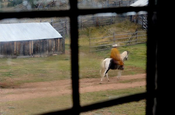 """Cowboy Fred can be seen riding Sky in the rain at Walker Ranch.<br /> Walker Ranch celebrated Autumn with a demonstration of life in the 1880's and a vintage baseball game on Sunday.<br /> For more photos and a video of Walker Ranch, go to  <a href=""""http://www.dailycamera.com"""">http://www.dailycamera.com</a>.<br /> Cliff Grassmick  / September 30, 2012"""