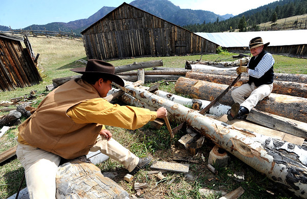 "Erick Yokomiszo, left, and Gene Joerns, show how you saw a log in the 1880's.<br /> Walker Ranch celebrated Autumn with a demonstration of life in the 1880's and a vintage baseball game on Sunday.<br /> For more photos and a video of Walker Ranch, go to  <a href=""http://www.dailycamera.com"">http://www.dailycamera.com</a>.<br /> Cliff Grassmick  / September 30, 2012"