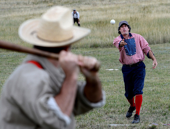 """Ivory Churchill pitches to Eric Cohen during the Walker Ranch Vintage baseball game.<br /> Walker Ranch celebrated Autumn with a demonstration of life in the 1880's and a vintage baseball game on Sunday.<br /> For more photos and a video of Walker Ranch, go to  <a href=""""http://www.dailycamera.com"""">http://www.dailycamera.com</a>.<br /> Cliff Grassmick  / September 30, 2012"""