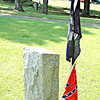 South women pay tribute to Southern valor by placing tiny Confederate battle flags at the graves of their honored dead.