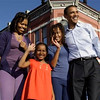 Democratic presidential candidate Sen. Barack Obama, D-Ill., waves at a rally with his wife Michelle Obama and daughters Malia Obama, 10, and Sasha Obama 7, in Pueblo, Colo. Saturday, Nov. 1, 2008.(AP Photo/Alex Brandon)