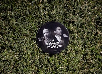 ** FILE ** In this Oct. 28, 2008 file photo, a campaign button showing images of Democratic presidential candidate Sen. Barack Obama, D-Ill., and the Rev. Martin Luther King Jr. is shown at a rally in Norfolk, Va. (AP Photo/Jae C. Hong, File)