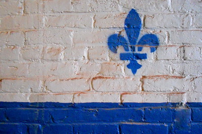 Fleur de lis, symbolizing of the contributions of Franco-American workers, on the wall inside the Bates Mill