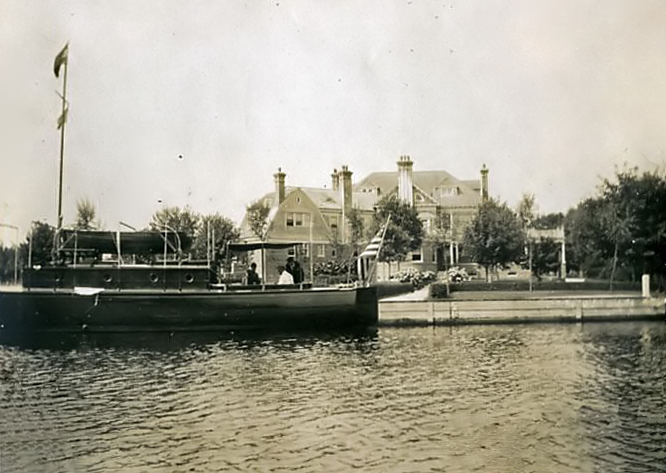 Waterfront home and yacht, 1907