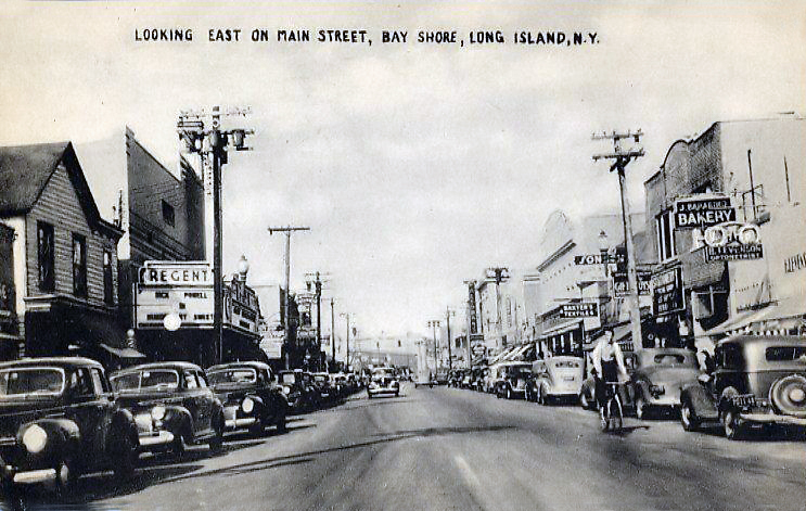 """Main Street looking east, Regent Theater to the left where """"Murder, My Sweet"""" with Dick Powell is showing.,1945."""