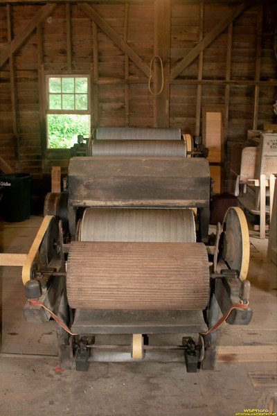 """Cotton Carder 3<br /> Beck's Mill - second floor, June 2010<br /> <br /> <br /> Evidently only 5 historical, operational cotton carding machines like this remain in the US today. I think these were originally imported from England in the early 1800's and were belt powered by the mill. Beck's Mill has 2 of them (1 pictured here) and the Smithsonian has 1 with the other 2 at other locations.<br /> <br /> Beck's Mill was founded December 1807 by George Beck Sr. If you visit Southern Indiana (Salem, IN area - near Spring Mill State Park) make sure to go and see Beck's Mill! It's well worth the admission cost and the funds go to support the mill. Photos from before and during the recent restoration can be found on the Mill's website at  <a href=""""http://www.friendsofbecksmill.org"""">http://www.friendsofbecksmill.org</a>."""