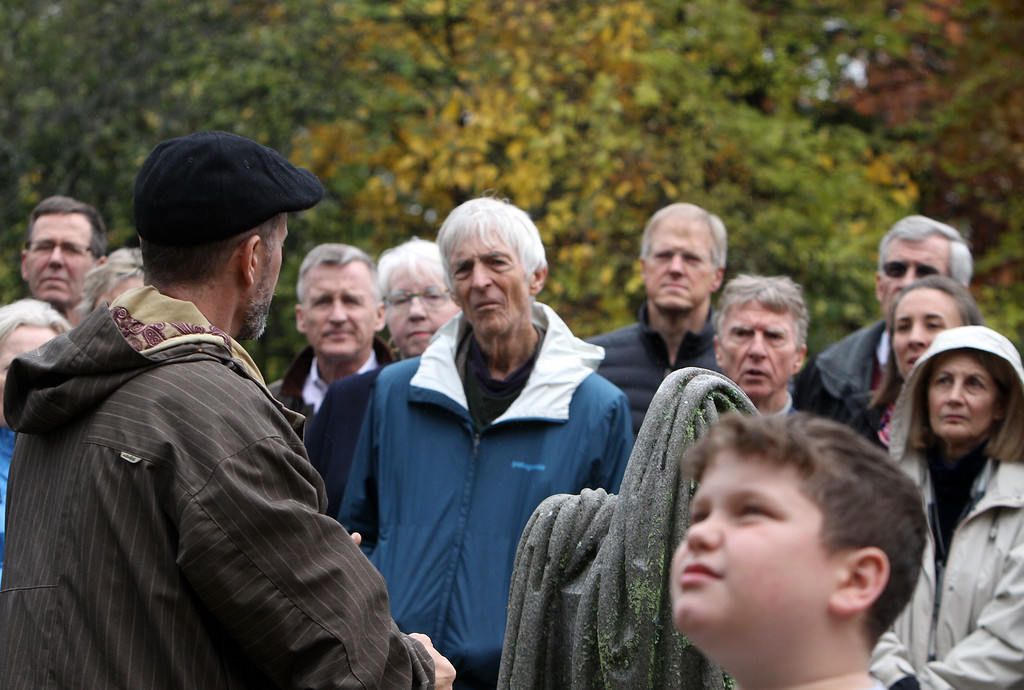 . Hildreth Cemetery holds its annual opening of the private cemetery. This year, they unveiled the sculpture by Bela Lyons Pratt, recently restored, on the grave of  Benjamin Butler. Jeff Buccacio Jr. of Natick, left, who restored the sculpture on Benjamin Butler\'s grave, talks about the work. At center rear (in blue/teal jacket) is Oakes Ames Plimpton of Arlington, a descendent of Butler. At right front is Buccacio\'s son Jeff Buccacio III, 9. (SUN/Julia Malakie)