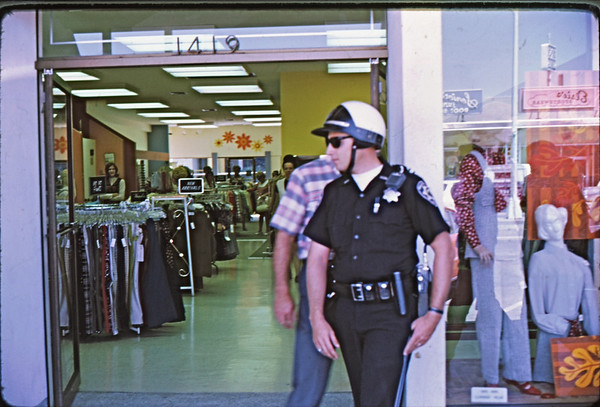 4*Sat, Aug 16, 1969<br /> *People: cop, sales ladies<br /> Subject: store entrance<br /> *Place: Walnut Creek<br /> Activity:  tour of suburbia<br /> Comments: keeping the peace