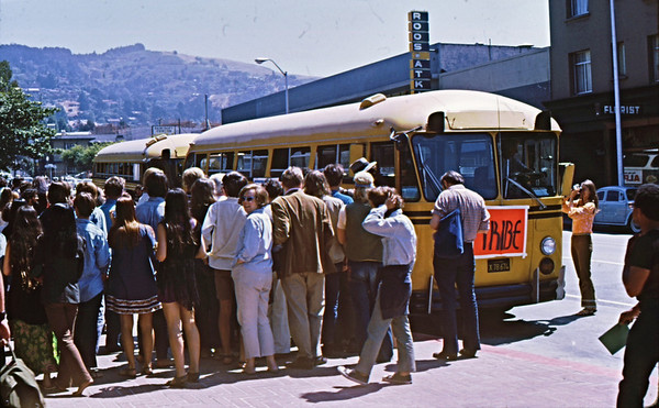 4*Sat, Aug 16, 1969<br /> *People: crowd Subject: Tribe bus *Place: Entrance to Sproul Plaza Activity: tour of suburbia<br /> Comments: sponsored by Berkeley Tribe, a free weekly for a few years along side of the longer lasting Berkeley Barb. I've got dozens of copies of both.