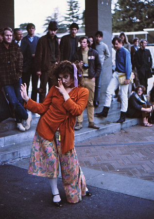 3*Fri, Jan 17, 1969<br /> *People: gypsy dancer, crowd<br /> Subject: dancer<br /> *Place: Sproul Plaza, UC Berkeley<br /> Activity: <br /> Comments:
