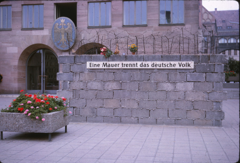"Streetside memorial:  ""A wall separates the German people, "" Berlin, 1964"