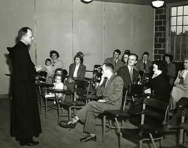 Father James Hannon, O.S.A., First Chaplain,  in the original Merrimack building (Guild Hall) on campus, circa 1950.