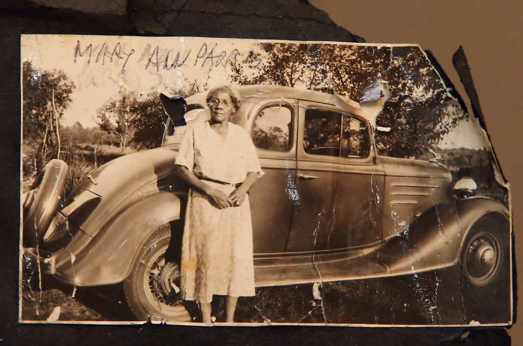 . B.J. Snowden�s great-grandmother, Mary Ann Parris, with the family car. Snowden�s great-grandparents are believed to be the first black family to buy a home in Billerica. SUN /JULIA MALAKIE