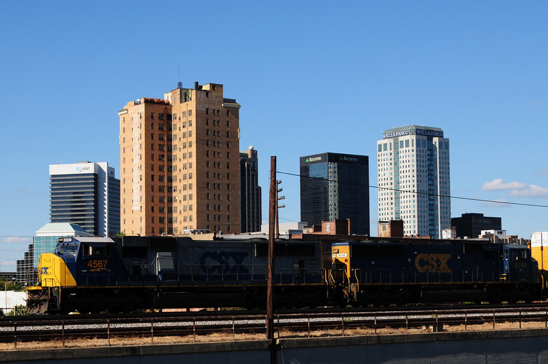 This is really cool how I got the engine of the train with the skyline in the background.