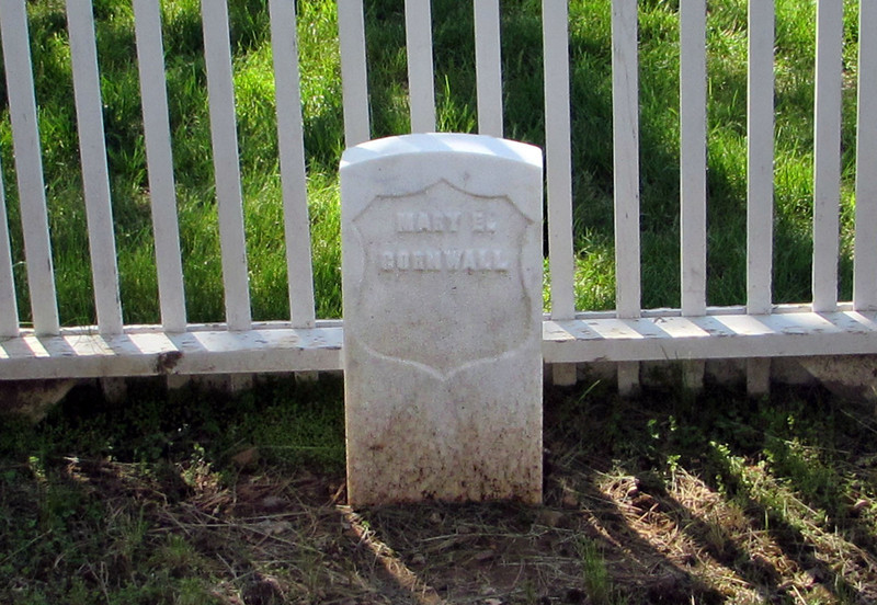 Grave marker for young Mary Cornwall, who died 15 August 1892 at Fort Meade.  While the circumstances surrounding Mary's death are unknown, the <i>Sturgis Weekly Record</i> reported that her funeral was one of the largest ever held at the post.