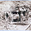 Title: Montana Mine<br /> Eight men, holding pick axes and shovels, standing in front of entrance to mine. 1889.<br /> Repository: Library of Congress Prints and Photographs Division Washington, D.C. 20540