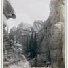 "Title: ""Lake Harney Peaks,"" near Custer City, S.D., on B. & M. Ry<br /> Close view of peaks; hikers sitting and standing on ridges. 1891.<br /> Repository: Library of Congress Prints and Photographs Division Washington, D.C. 20540"