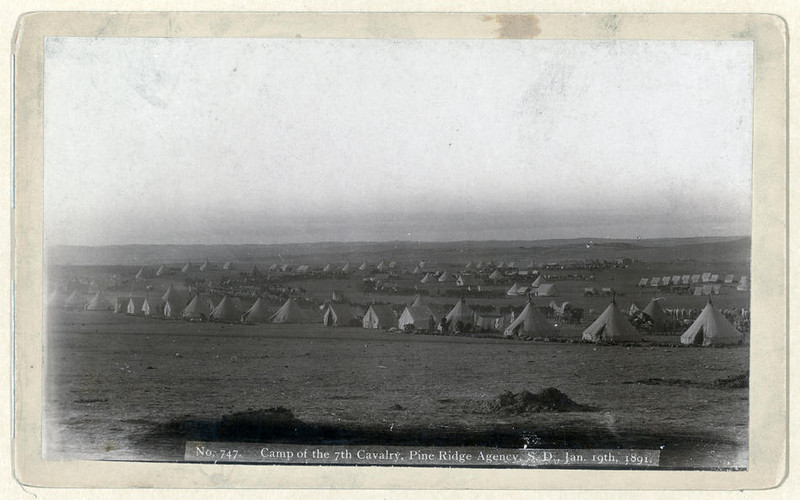 Title: Camp of the 7th Cavalry, Pine Ridge Agency, S.D., Jan. 19, 1891<br /> View of military camp: tents, horses, and wagons.<br /> Repository: Library of Congress Prints and Photographs Division Washington, D.C. 20540