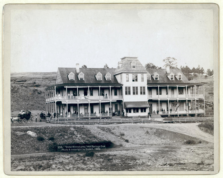 "Title: ""Hotel Minnekahta,"" Hot Springs, Dak.<br /> Front view of hotel with men and women posed on the porches and balcony. 1889.<br /> Repository: Library of Congress Prints and Photographs Division Washington, D.C. 20540"