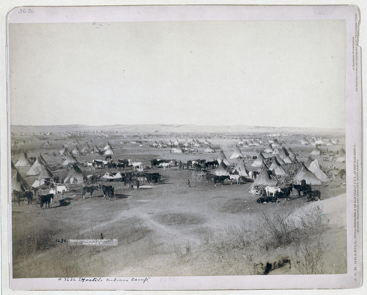 "Title: ""Hostile Indian camp""<br /> Bird's-eye view of a large Lakota camp of tipis, horses, and wagons--probably on or near Pine Ridge Indian Reservation. 1891.<br /> Repository: Library of Congress Prints and Photographs Division Washington, D.C. 20540"