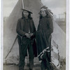 "Title: ""Red Cloud and American Horse."" The two most noted chiefs now living<br /> Two Oglala chiefs, American Horse (wearing western clothing and gun-in-holster) and Red Cloud (wearing headdress), full-length portrait, facing front, shaking hands in front of tipi--probably on or near Pine Ridge Reservation. 1891.<br /> Repository: Library of Congress Prints and Photographs Division Washington, D.C. 20540"